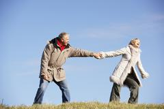 Senior Man Pulling His Wife By The Hand - stock photo
