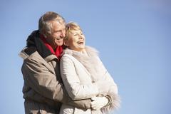Senior Couple Embracing In Park Stock Photos