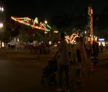 Family walks through Carnival Stock Footage