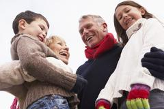Grandparents Hugging Their Grandchildren - stock photo