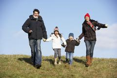 Family Running In The Park - stock photo