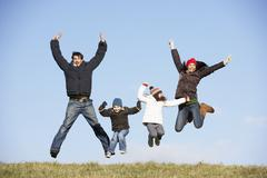 Family Jumping In The Air - stock photo