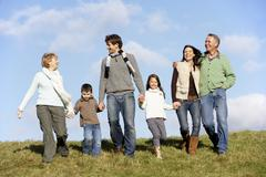 Family Walking In The Park Stock Photos