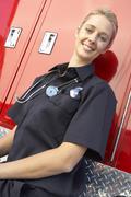 Portrait of female paramedic - stock photo