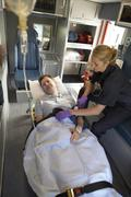 Paramedic with patient in ambulance Stock Photos