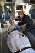 Stock Photo of Paramedic with patient in ambulance