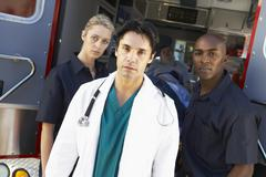 Stock Photo of Doctor and paramedics standing in front of an ambulance