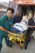 Stock Photo of Paramedics and doctor unloading patient from ambulance