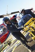 Paramedics unloading patient from Medevac - stock photo