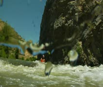 Whitewater kayaking shots with underwater camera Stock Footage