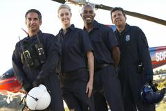 Portrait of paramedics standing in front of Medevac - stock photo