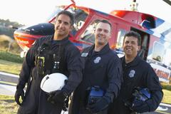 Portrait of paramedics standing in front of Medevac Stock Photos