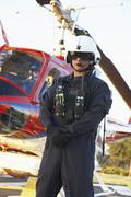 Portrait of paramedic standing in front of Medevac Stock Photos
