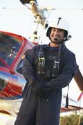 Portrait of paramedic standing in front of Medevac - stock photo