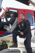Portrait of pilot and paramedic by Medevac - stock photo