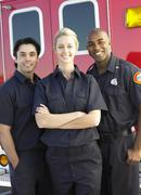 Stock Photo of Portrait of paramedics standing in front of an ambulance