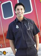 Stock Photo of Portrait of paramedic in front of ambulance