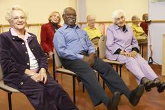 Senior adults in a stretching class Stock Photos