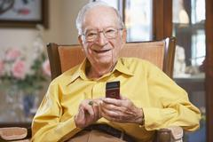 Senior man text messaging - stock photo