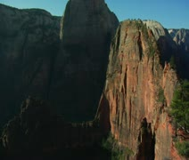 Pan down from redrock cliffs and mountains - stock footage