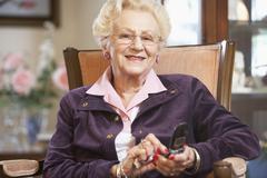 Senior woman text messaging Stock Photos