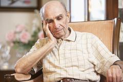 Senior man resting in armchair Stock Photos