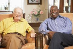 Senior men relaxing in armchairs - stock photo