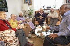 Stock Photo of Senior adults having morning tea together