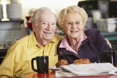 Senior couple having morning tea together Stock Photos