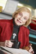 Senior woman drinking tea - stock photo