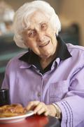 Senior woman having morning tea Stock Photos