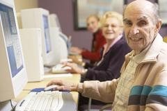Senior man using computer - stock photo