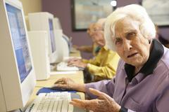 Senior woman using computer Stock Photos