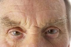 Close-up of senior man - stock photo