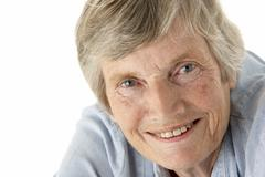 Portrait of senior woman smiling at the camera Stock Photos
