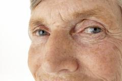 Close-up of senior woman - stock photo