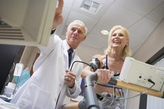 doctor with patient during health check - stock photo