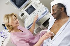 nurse giving patient an ultra sound - stock photo