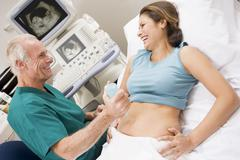Stock Photo of doctor giving patient an ultra sound