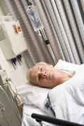 Patient In Hospital Bed Stock Photos
