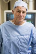 Portrait Of Surgeon In Surgical Scrubs - stock photo