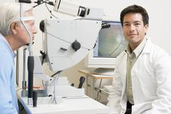 Doctor And Patient Ready For An Eye Exam Stock Photos