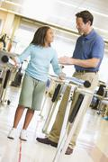 Physiotherapist With Patient In Rehabilitation - stock photo