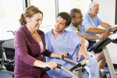 Nurse With Patient In Rehabilitation Using Exercise Machine Stock Photos