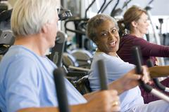 Patients Working Out In Gym - stock photo