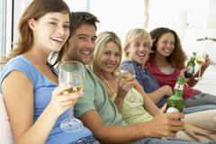 Friends Enjoying A Drink Together Stock Photos