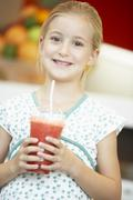Young Girl Drinking A Berry Smoothie Stock Photos