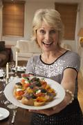 Woman With Hors D'oeuvres For A Dinner Party - stock photo