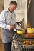 Man Cooking At Home - stock photo