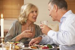 Couple Enjoying A Meal At Home Together - stock photo